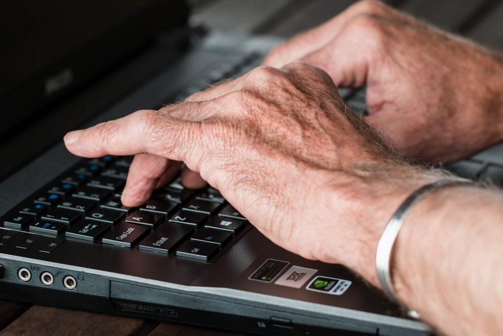 hands typing computer